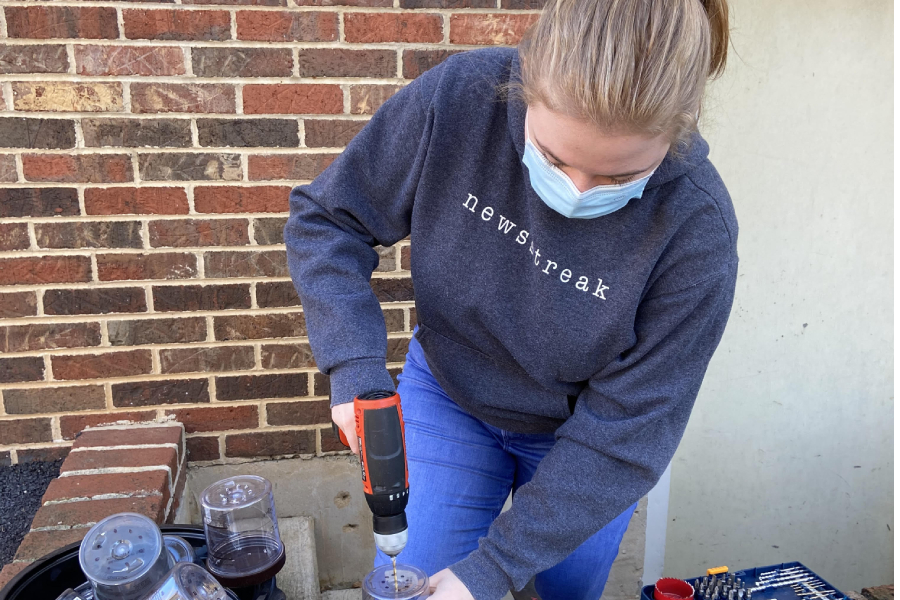 Senior+Betsy+Quimby+drills+to+work+on+her+vertical+farm+engineering+project.+Quimby+and+her+partner%2C+senior+Mia+Constantin%2C+entered+this+farm+in+the+Shenandoah+Valley+Regional+Science+and+Engineering+Fair%2C+and+the+pair+won+a+bronze+medal.