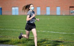 Freshman Abby Vance runs on the track during a practice. Vance ran in the 400m dash and the 4x400m relay in the meet.