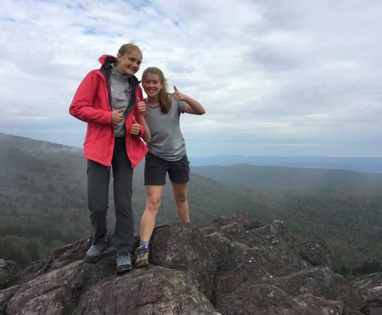 Amelia Mitchell (left) and Emma Lankford (right) pose during a backpacking trip at Grayson Highlands.