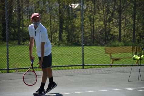 During a practice, sophomore Corey Beshoar gets ready to serve.