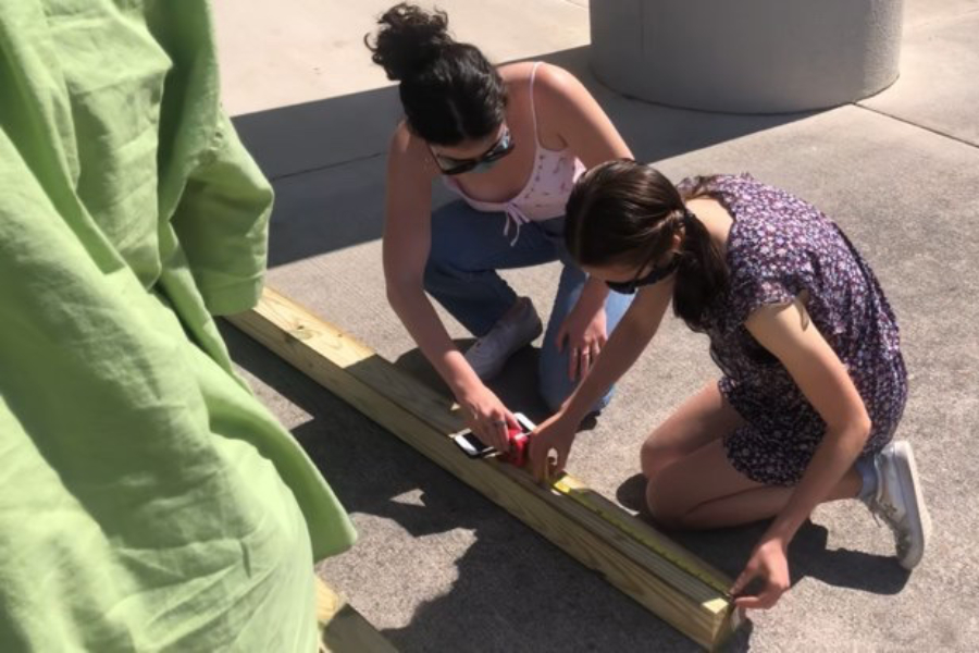 Seniors Cecelia Thomas and Lizzy Healy work on building the table part of the project.