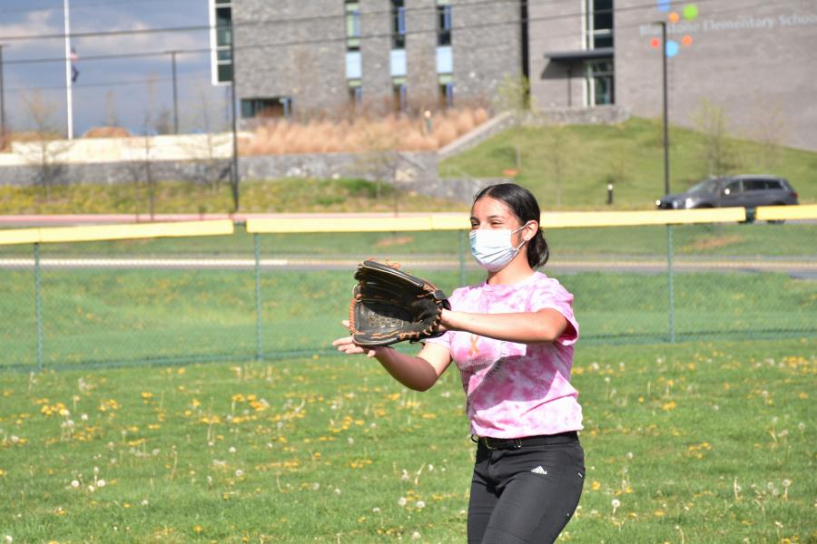 Freshman Idaly Alvarez catches the ball at softball practice.