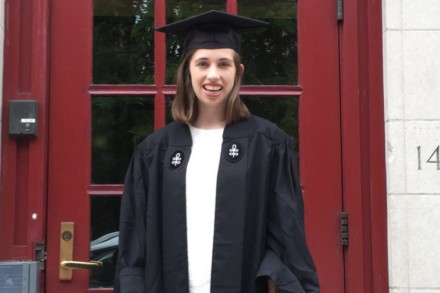 HHS alumna Mia Karr poses in her cap and gown for her college graduation. Karr attended Harvard University, and she is currently pursuing screenwriting.