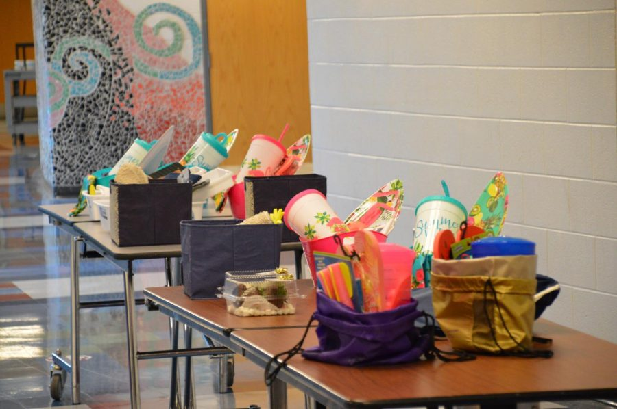 Prize baskets for seniors lined up on a table.