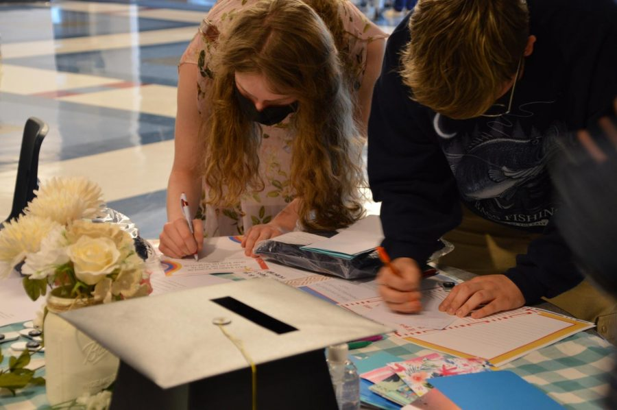 "Two seniors write ""thank you"" cards."