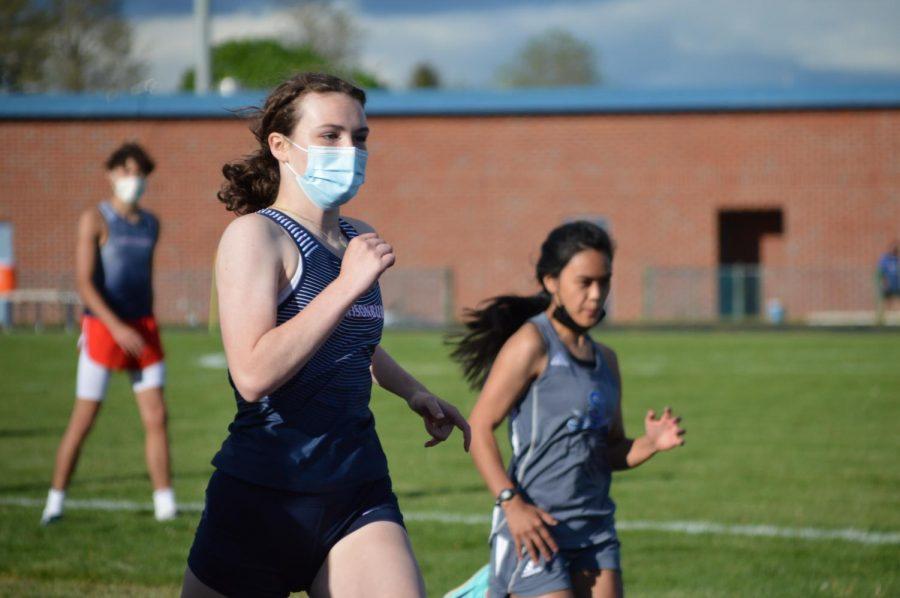 Freshman Grace Bush runs ahead of a Spotswood runner.