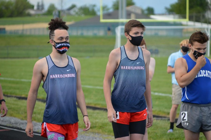 Sophomore Evan Geisler and freshman Caleb Bergey stand on the starting line waiting for their race to begin.
