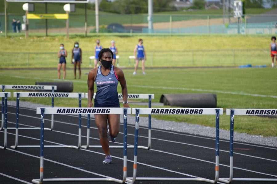 Sophomore Mia Beauzieux prepares to jump over her last hurdle.