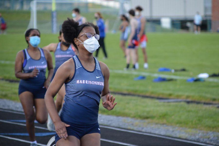 Freshman K'lasia Robinson runs ahead of two other Harrisonburg runners.