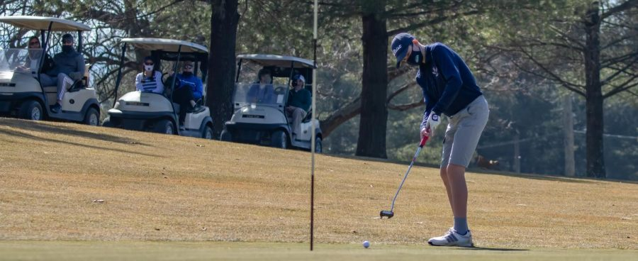 Sophomore Toby Corriston golfs at the state competition.