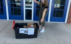 Junior Juju Butler poses outside the school for a HOSA food bank event.