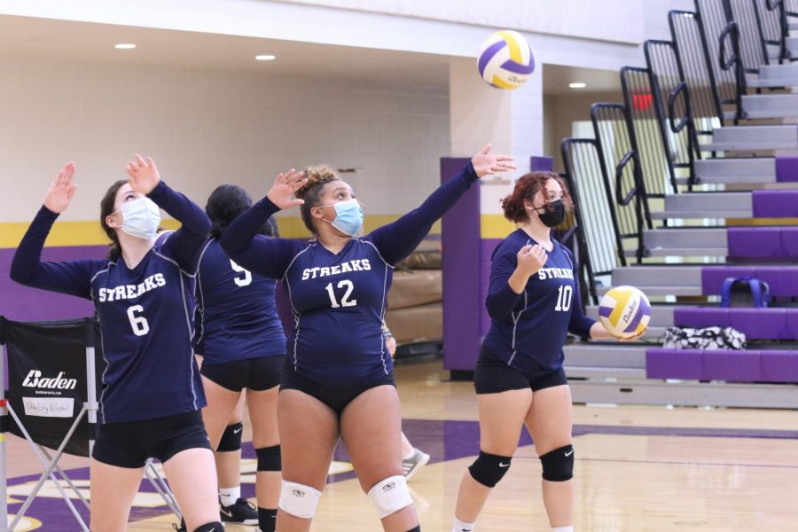 Knight (12) serves the ball before the start of the match.