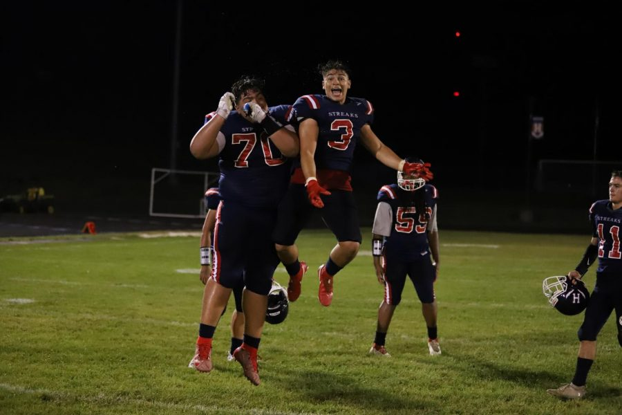 After the win, senior Guillermo Lopez (right) and junior Joel Alvarado (left) celebrate on the field.