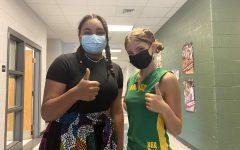 Freshman Misha Sarco (left) and sophomore Sophia Pimentel Yoder (right) participate in culture day.
