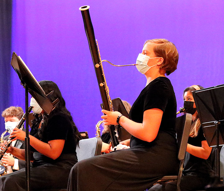 Sophomore+Johanna+Mayfield+plays+the+bassoon+through+her+mask.