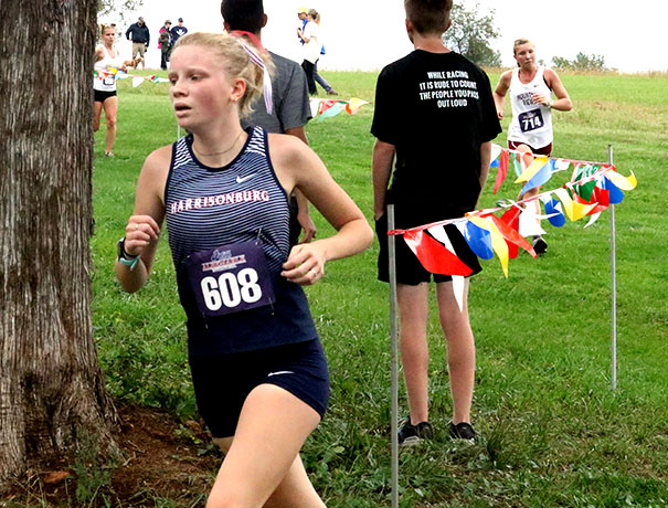 Sophomore Lena Blagg runs the final stretch of her race.