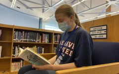 Sophomore Ellie Alcombright reads the book, Flora and Ulysses.