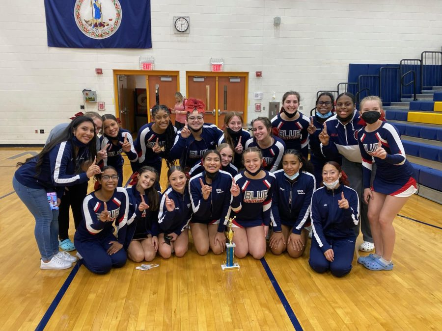 Varsity competition cheerleading team poses after first competition, where they won first place.