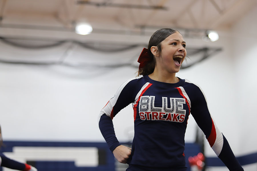 Sophomore Timberlyn Moore cheers for the streaks.